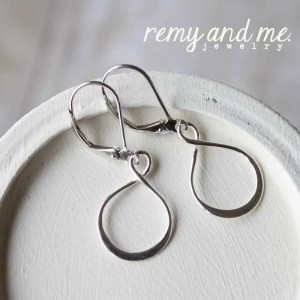 Sterling silver infinity dangle earrings on leverback earwire.